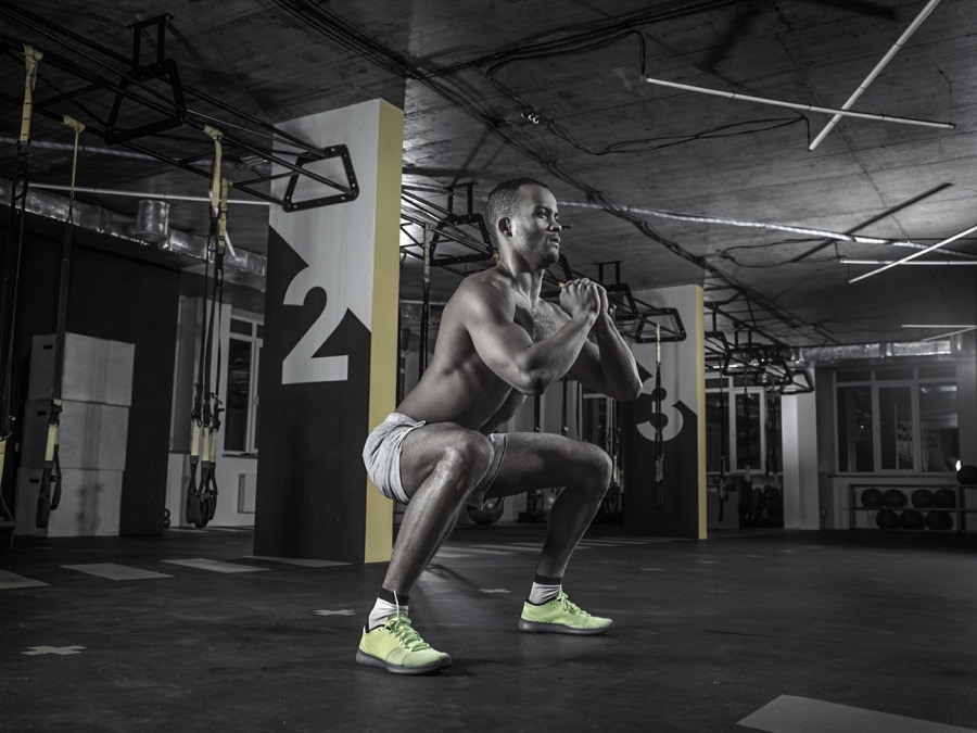 Male athlete is exercising in the gym for making his body strong.